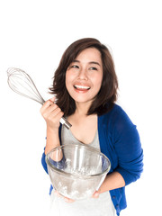Isolated portrait of beautiful young success woman with whisk an