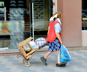 Senior woman pushing a cart