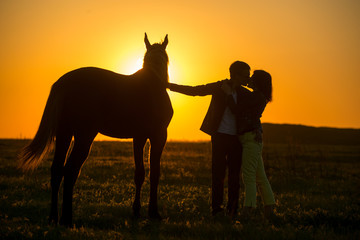 man and woman in horse