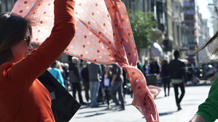 Women waving scarf on the street, slow motion shot at 240fps, st