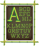 Fototapety bamboo frame with canvas and stylized alphabet