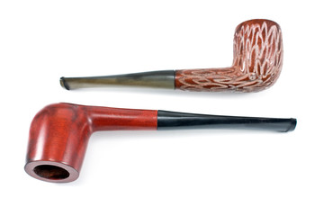 Two tobacco pipes isolated on white
