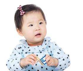 Kid girl playing toy block
