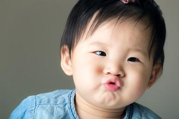 Asian baby girl purse lip
