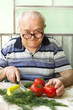 elderly man preparing healthy food