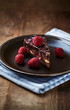 Chocolate Cake with Raspberries on a Plate