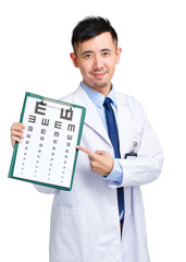 Male doctor keeping optometry chart