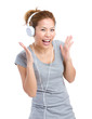 Excited woman listening to headphone