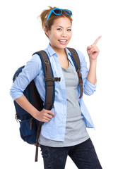 Asian backpacker with finger pointing up