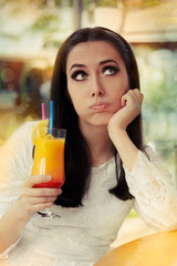 Bored Woman with Colorful Cocktail Drink