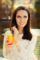 Young Woman with Colorful Cocktail Drink Outside