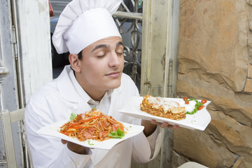 Chef enjoys the smell of spaghetti and lasagna.