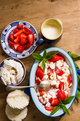 Meringue, cream and strawberries dessert