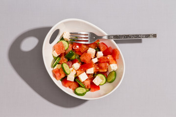 Bowl of fresh tasty Mediterranean salad
