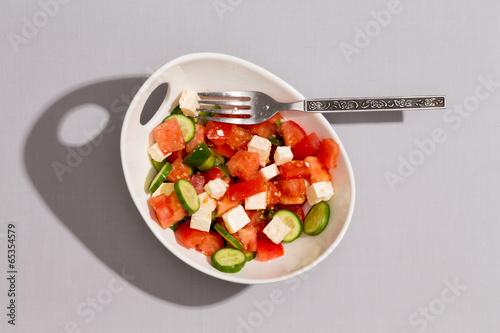 Bowl of fresh tasty Mediterranean salad
