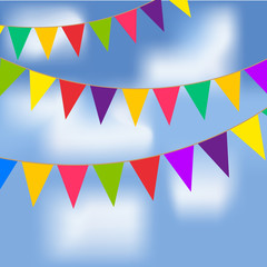 Party flags with blue sky and white clouds