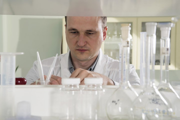 scientist in laboratory work with test-tube white