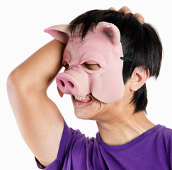 Man wearing pig mask with headache