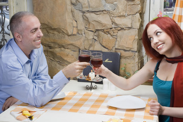 Young couple toast with red wine.