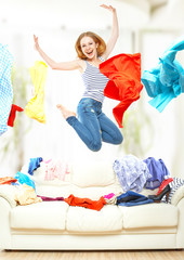 Funny girl with flying clothes jumping at home