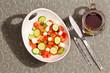 Healthy fresh feta salad with a mug of hot tea