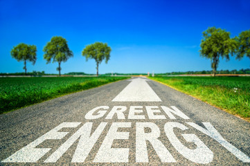 Green energy word painted on asphalt road