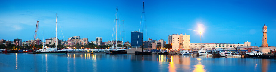 evening panorama of Port Vell and Barceloneta