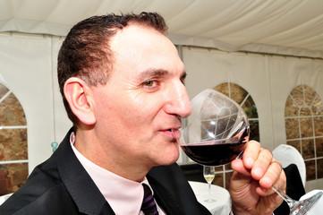 Man drinking red wine.