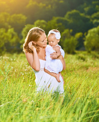 happy family on nature mother and baby daughter
