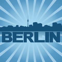 Berlin skyline reflected with blue sunburst illustration