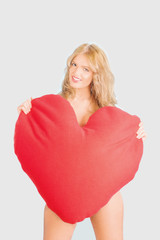 Beautiful woman with heart shaped cushion