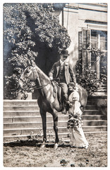 antique photo. portrait young couple wearing vintage clothing