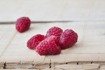 fresh local raspberries macro shot on rustic wooden background