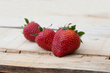 fresh local strawberries macro shot on rustic wooden background