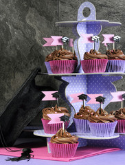Graduation day pink and purple party chocolate cupcakes on stand