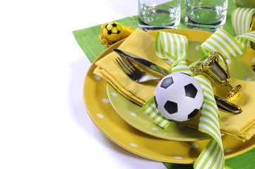 Soccer football party table in yellow and green team colors