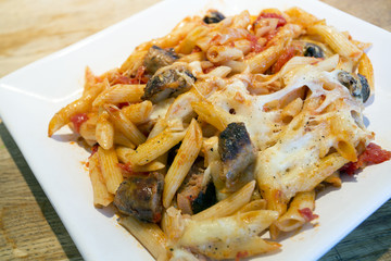 sausgae and tomato and mozzarella cheese pasta bake