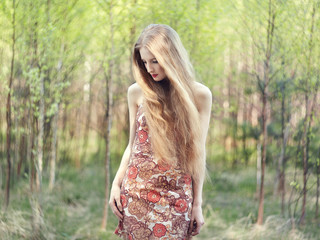 Beautiful young woman in summer garden