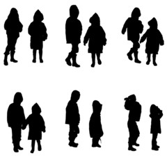 Vector silhouette of children in raincoats.