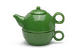 Set of a green ceramic teapot and mug isolated on a white backgr