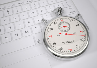 Sports stopwatch lying on a computer keyboard
