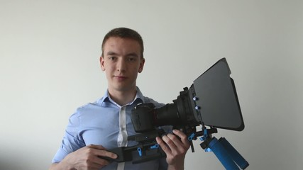 man with professional camera (rig) and smiles