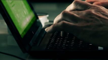 Hacker typing program   on a laptop keyboard