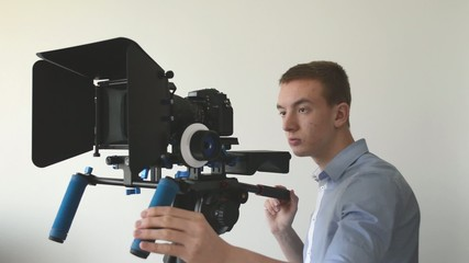 man films with professional camera