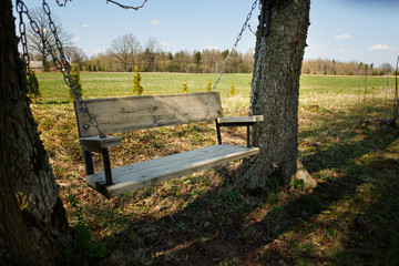 Comfortable swing bench between two trees