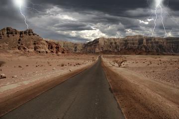 Narrow road through the desert in Israel.