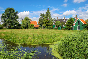 Small creek and rural houses in Dutch village.