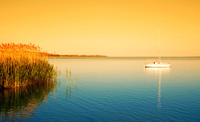 Sailboat on Lake Balaton in sunrise