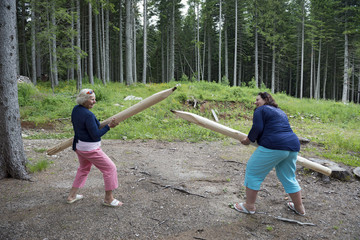 Funny outdoor play with timber similar to big pencils.