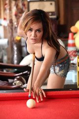 Asian model on pool table